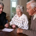 Trimnal & Myers, elderly couple signing papers