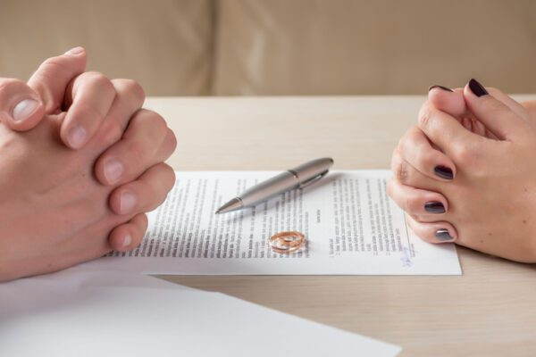 Trimnal & Myers, wife and husband signing divorce documents or premarital agreement