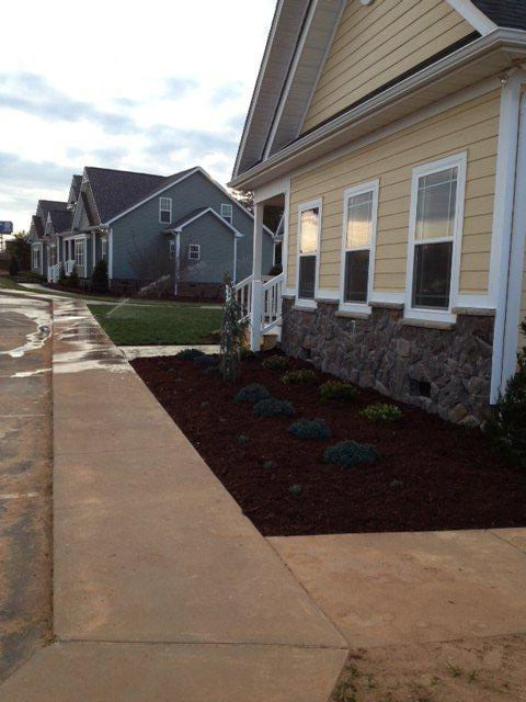 EnviraScape LLC | Newly landscaped area on the side of e of a new home
