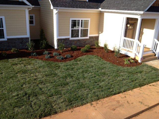 EnviraScape LLC | Completed landscaping in front of a home with fresh sod
