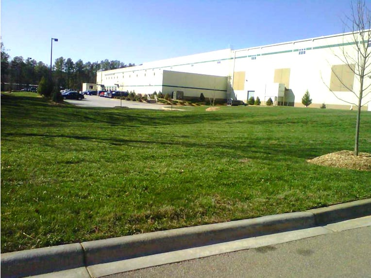 EnviraScape LLC | Professionally mowed lawn on business grounds