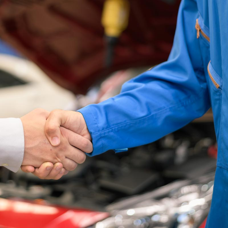 Car service, vehicle repair at Carolina Collision. Carolina Collision technician shaking hands with vehicle owner customer after sending car for repairing or check at Carolina Collision.