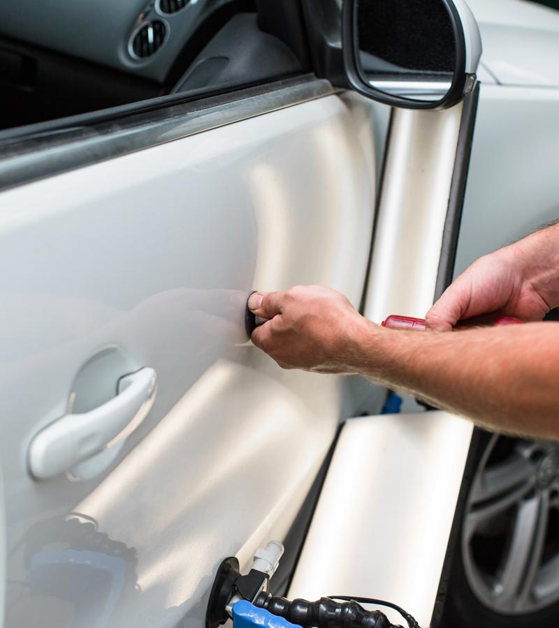 Carolina Collision Repairing car dent after the accident by paintless dent repair