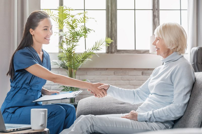 Riverview Hospice and Palliative Care LLC   Nurse meeting with an older woman as a patient