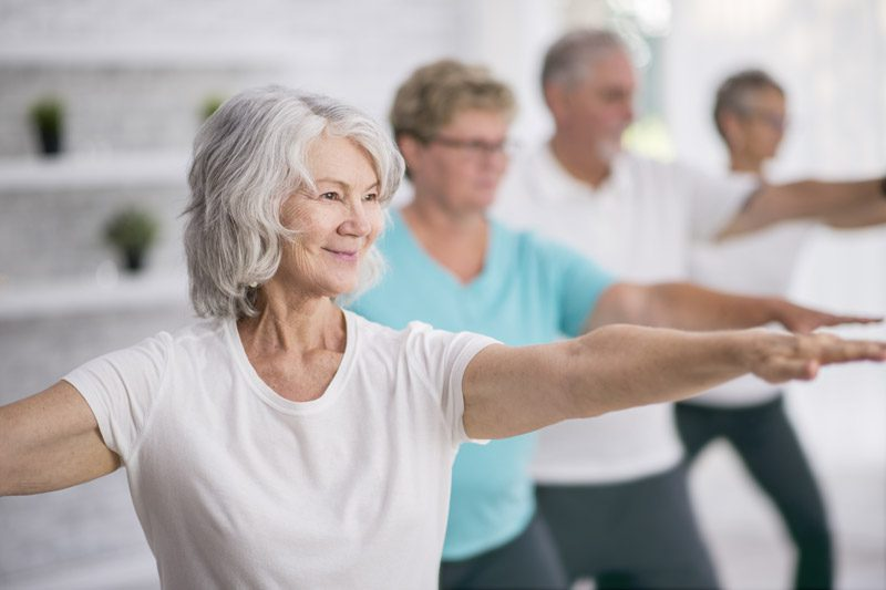 Riverview Hospice and Palliative Care LLC | Older group of men and women stretching and exercising