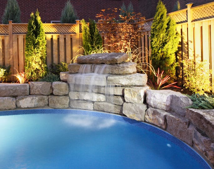 Nick's Pool Service | Fort Mill, SC | Fencing and waterfall for built-in pool