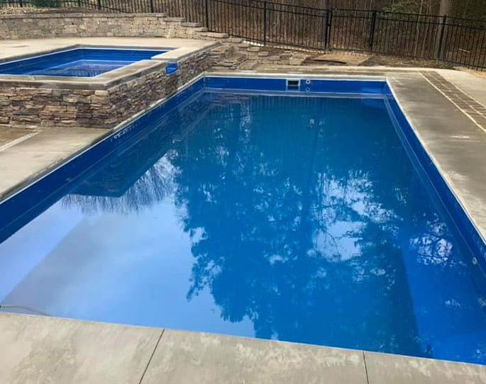 Nick's Pool Service | Fort Mill, SC | beautiful new stone and concrete built-in pool by Nicks Pool Service