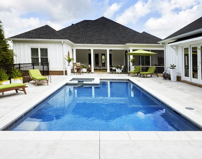 Nick's Pool Service | Fort Mill, SC | built-in pool surrounded by wrought iron fence and concrete patio