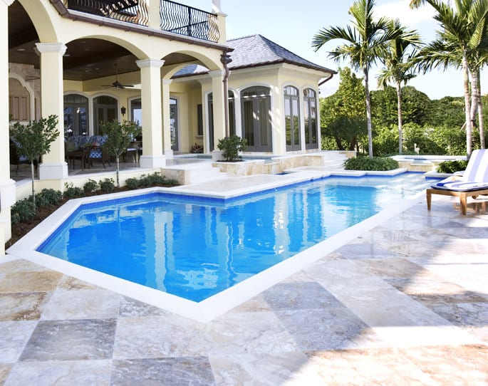Nick's Pool Service | Fort Mill, SC | tile patio in backyard with built-in pool