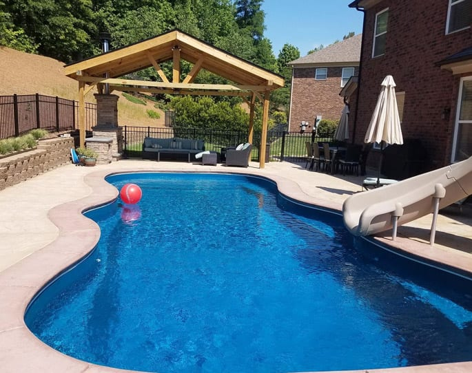 Nick's Pool Service | Fort Mill, SC | built-in pool surrounded by concrete and landscaping