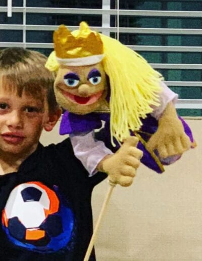 Creative Kids Fort Mill | little boy playing with a puppet