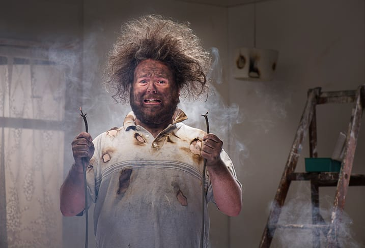 Palmetto Electrical Contractors | man with blackened face and frizzed out hair suffering a shock trying to do his own electrical work