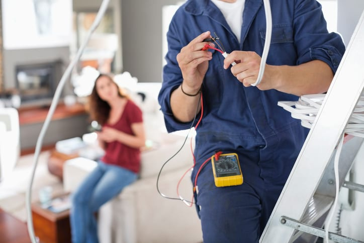 Palmetto Electrical Contractors   electrician working in a living room
