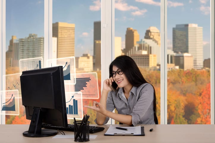 Palmetto Electrical Contractors | business woman talking on phone in front of a computer