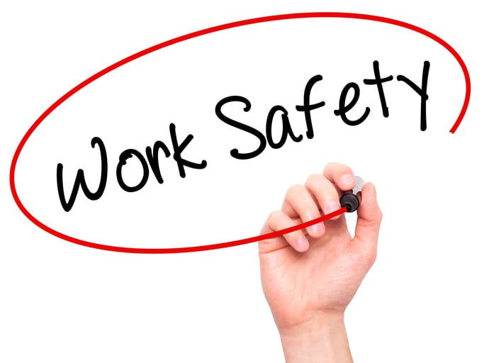 Palmetto Electrical Contractors | hand with a marker writing Work Safety in a red circle