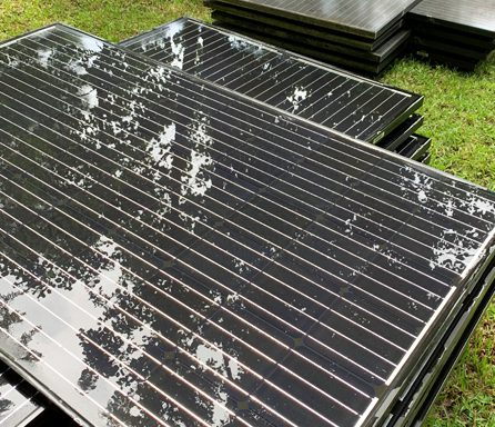 Ben Ross Roofing   Solar panels cleaned up on ground before installation on roof