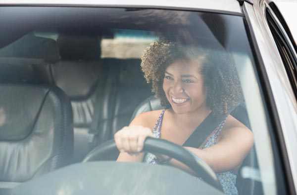 Woman Happy Driving with new glass